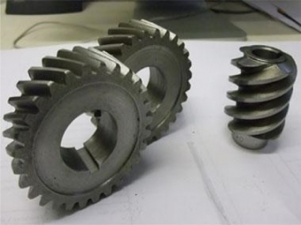 Two helical gears and worm gear